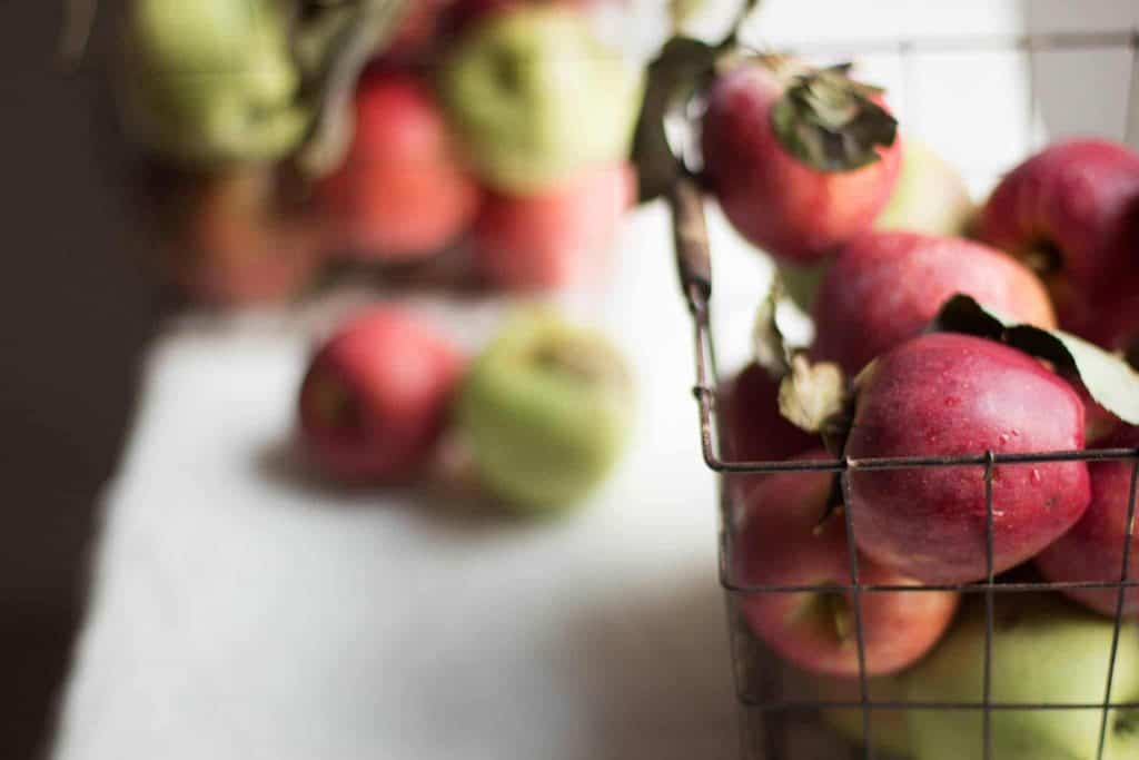 Apples in wire baskets