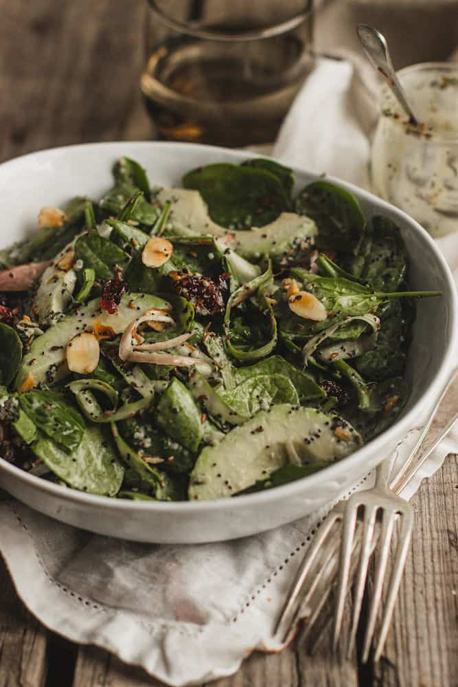 Spinach salad with avocados and slivered almonds