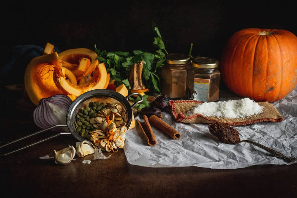 Pumpkin soups ingredients displayed a a still life way painting way