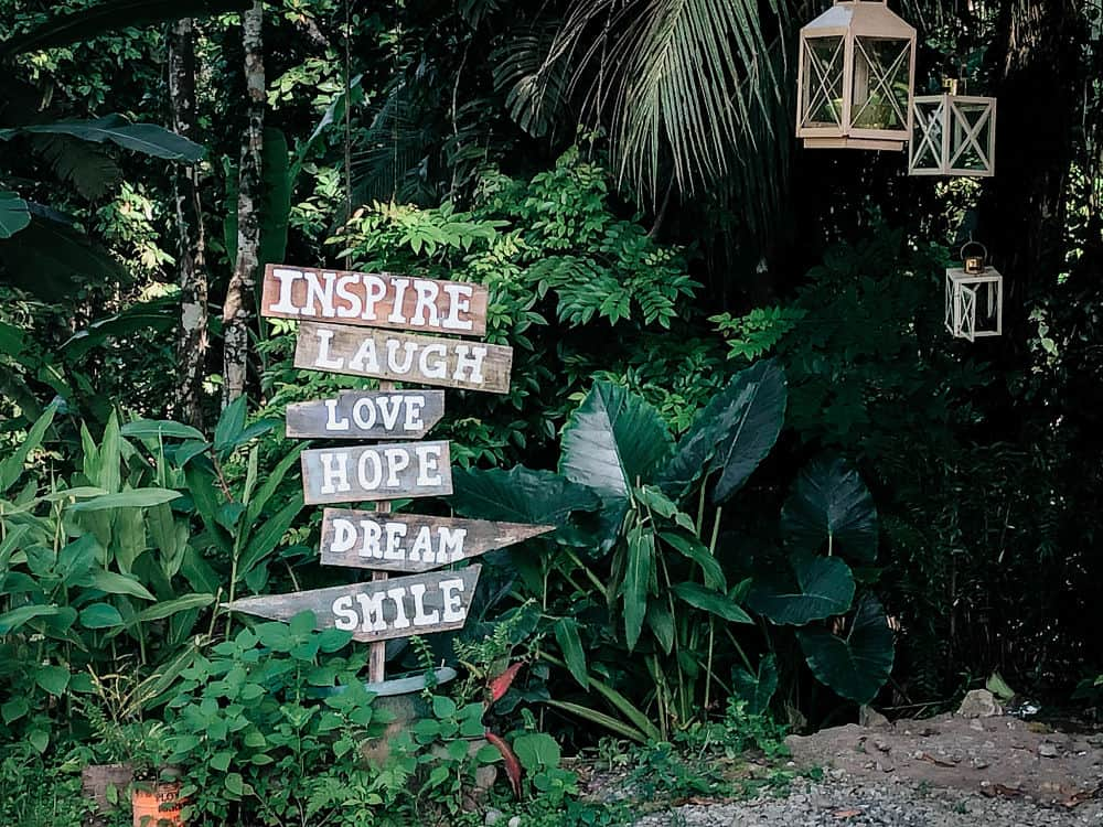 Inspiration signs in front of green leaves in Costa Rica Trip - Puerto Viejo
