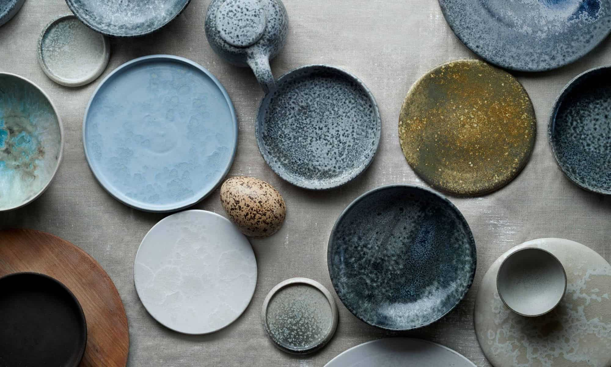 Bird's eye view of rustic plates of different shades of grey