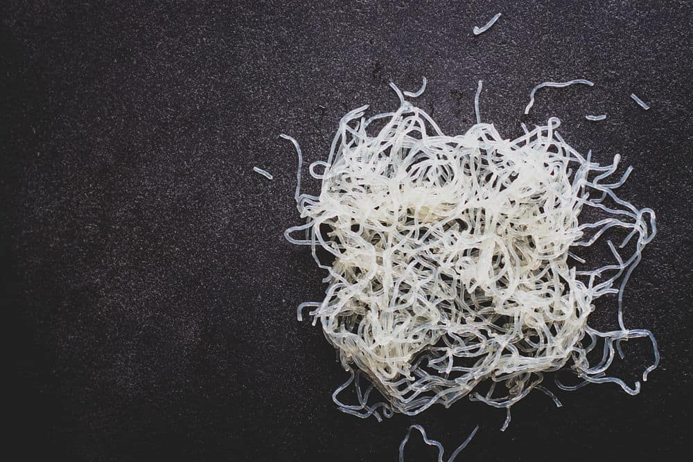 Top view of kelp noodles on a black surface