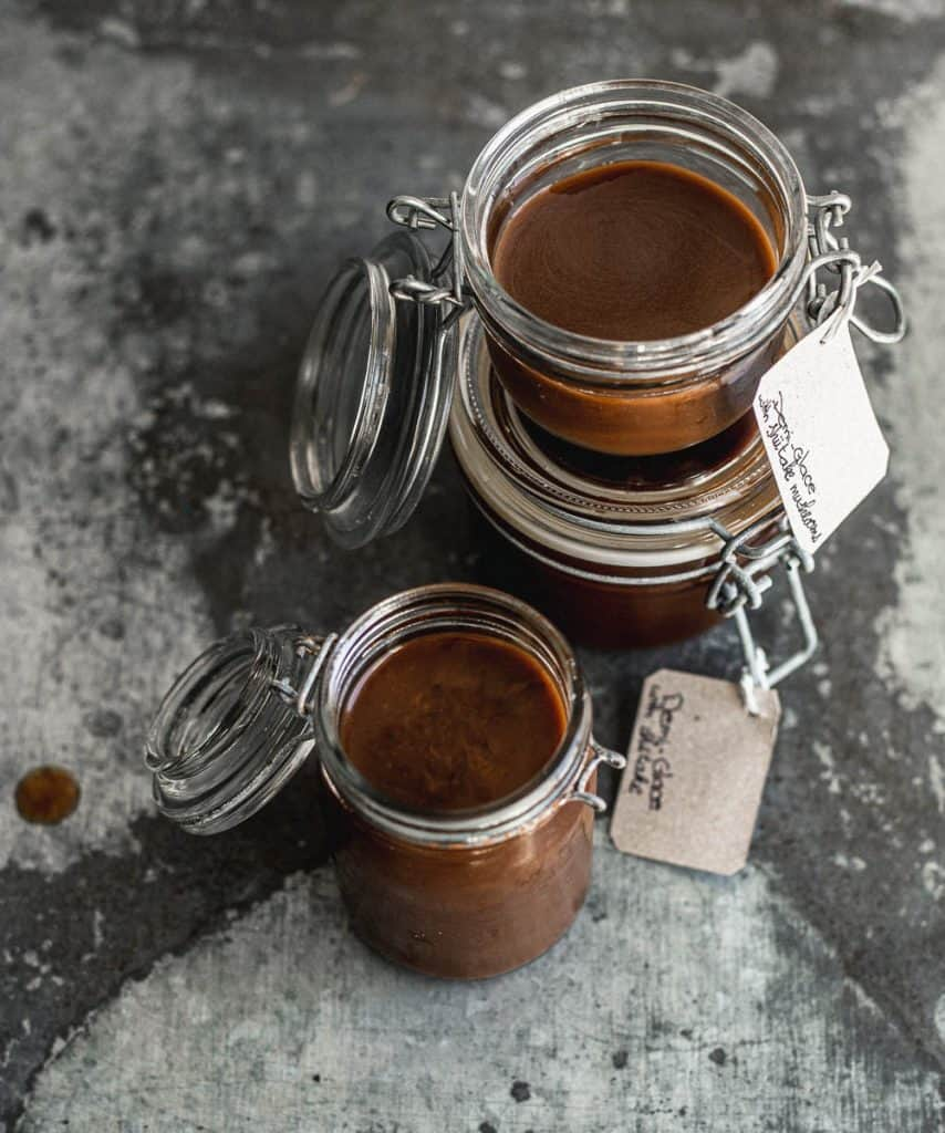 Small jars of demi-glace sauce