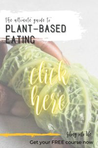 Hand rolling a cabbage leaf, reading the ultimate guide to plant-based eating, click here, get your free course now
