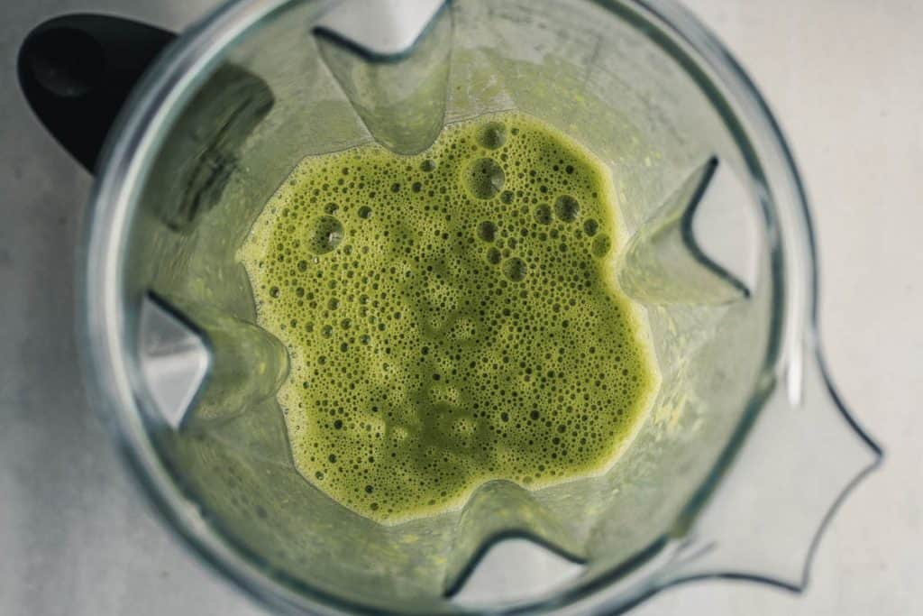 Overhead view of mashed peas in a blender