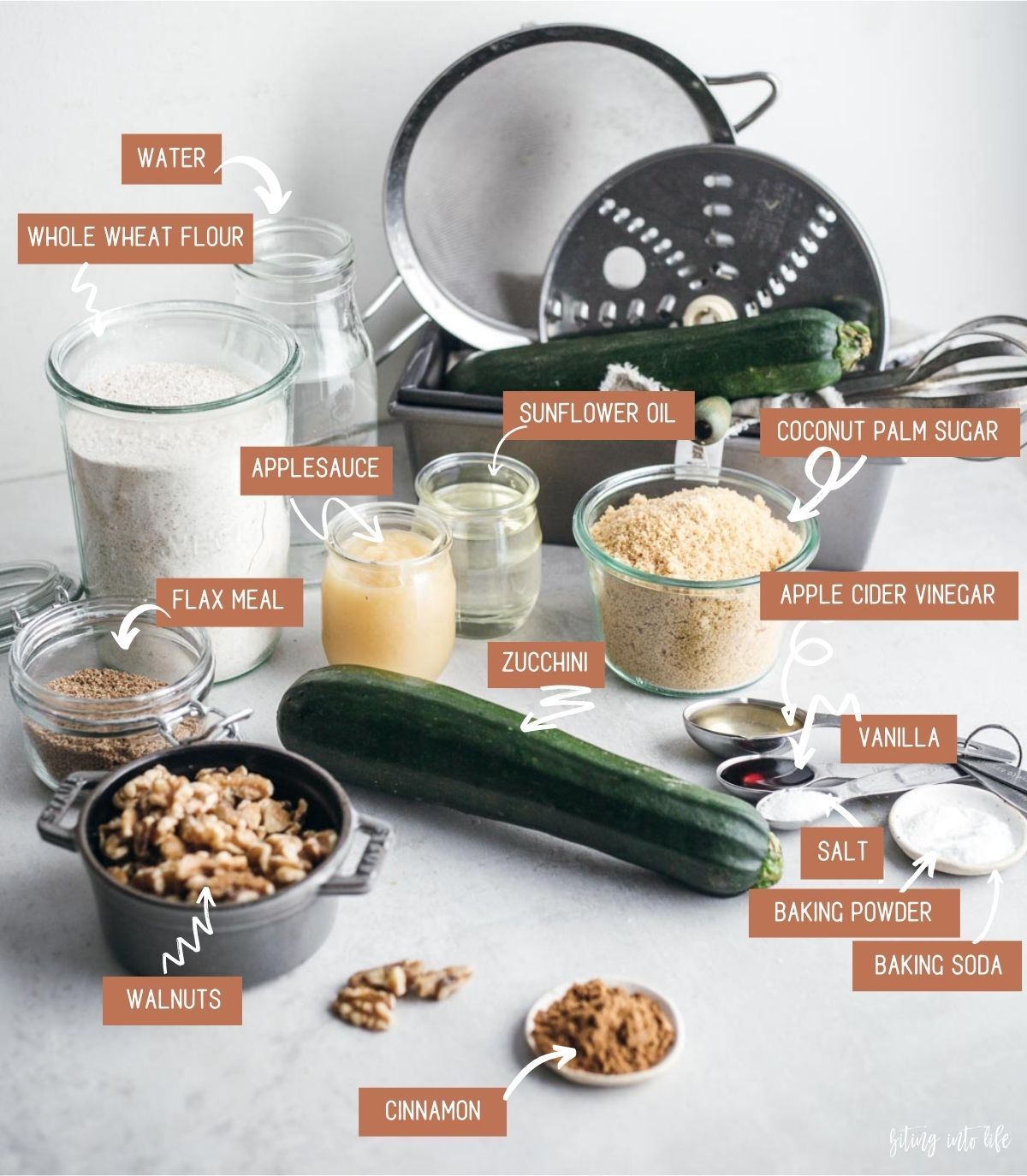 Vegan zucchini bread ingredients spread on a surface
